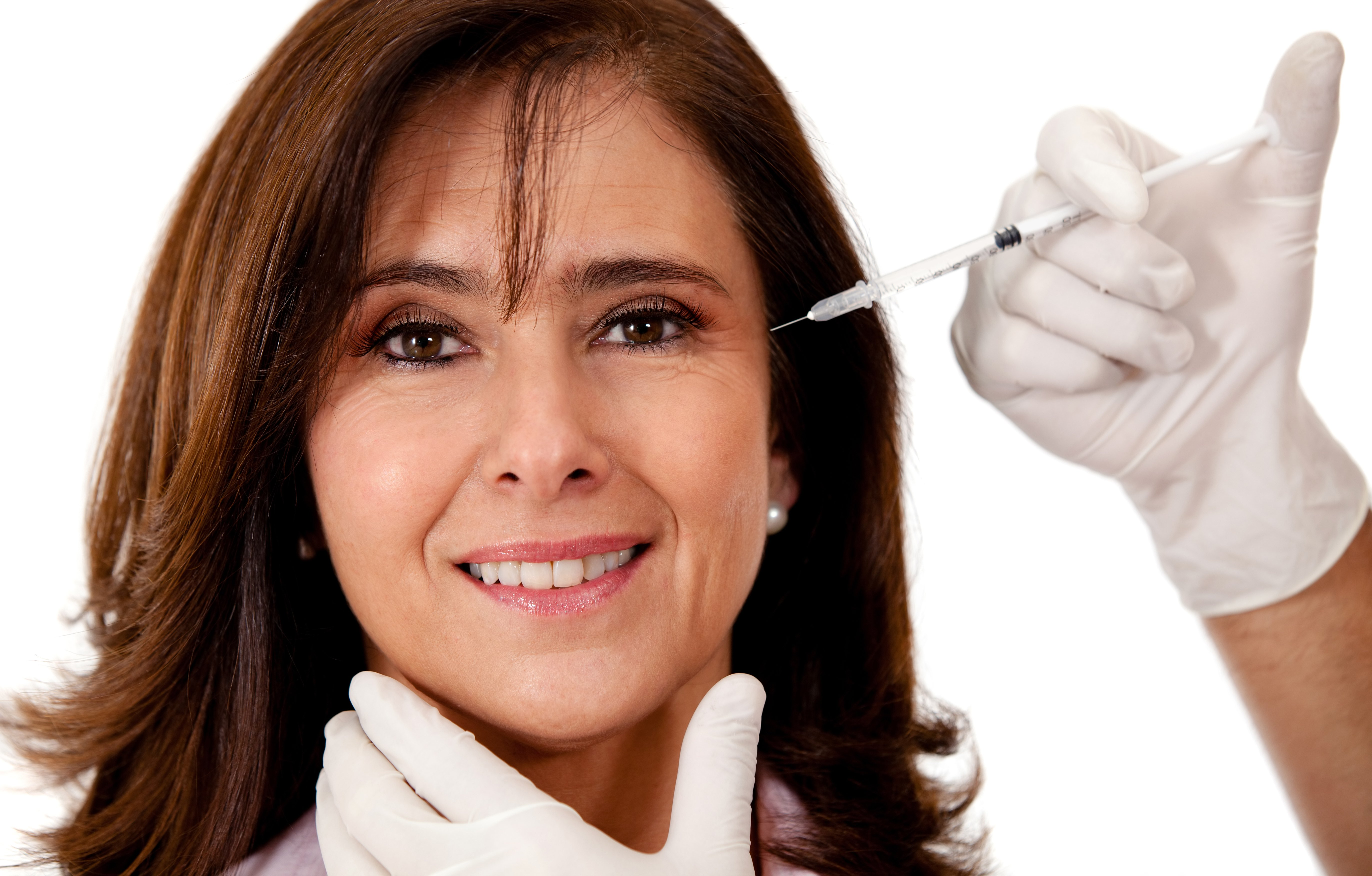 Woman getting a face lift with Botox - isolated over a white backgroun